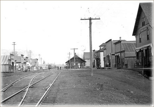 Early Sandpoint the Northern Pacific tracks cut through the center of town. The original depot is in the distant center on the east side of the tracks. The wood-framed businesses lined both sides of the track.  Several fires destroyed many of the businesses in 1900. Courtesy of the Bonner County Historical Museum.