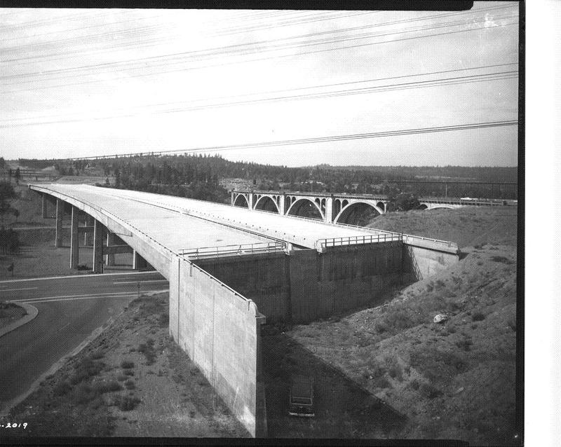 The I-90 bridge spanning Latah Creek under construction, 1964 (image L87-1.1978-64 courtesy of the Northwest Museum of Arts and Culture)