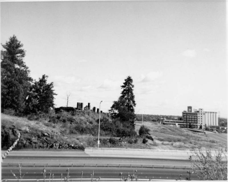 The remaining columns of the promenade in Liberty Park as seen looking south across the the I-90 freeway. Sperry/Centennial flour mill visible in distance, ca. 1970s (image courtesy of the digital collection, Northwest Room, Spokane Public Library)