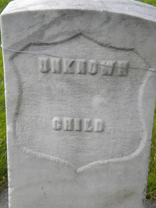 One of many child grave markers
