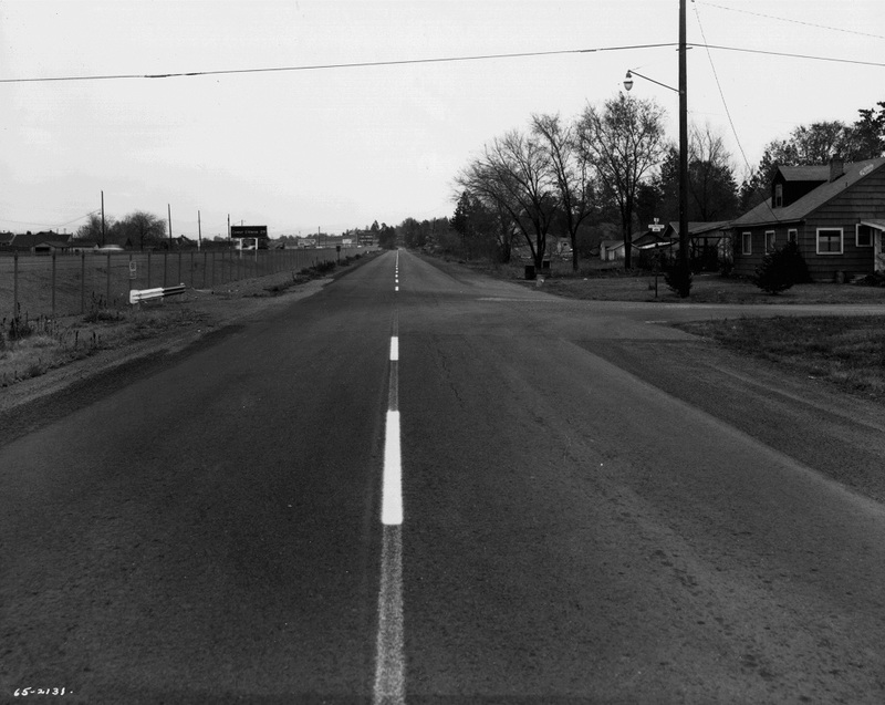 The construction of I-90 reduced traffic on East Central streets (image of 4th and Carnahan, L87-1.2131.65 courtesy of the Northwest Museum of Arts and Culture).