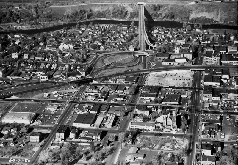 This 1964 image illustrates the way I-90 divided neighborhoods.  All of the structures in this image below the spires of First Presbyterian church were demolished for freeway construction (image L87-1.2280-64 courtesy of the Northwest Museum of Arts and Culture).