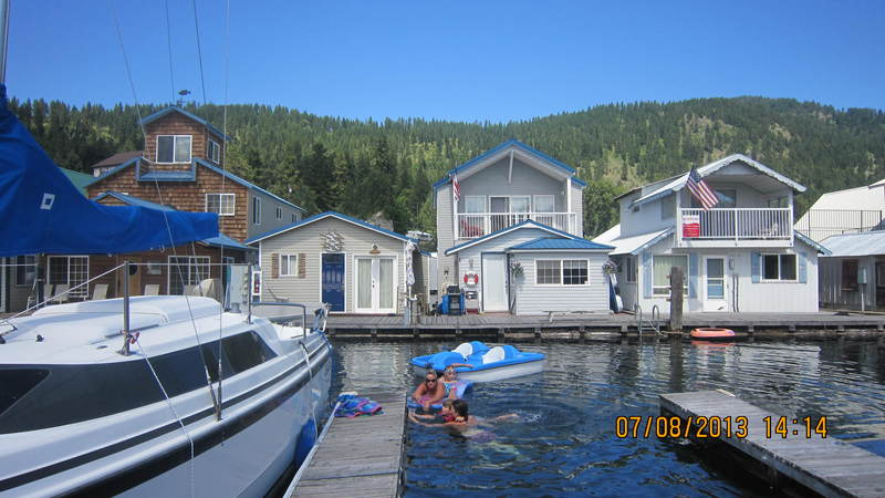 The two story float homes resemble little cabins on the lake.