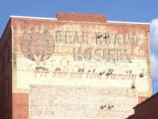 """Painted ghost signs """"Bear Brand Hosiery,"""" """"Fit for all the family."""""""