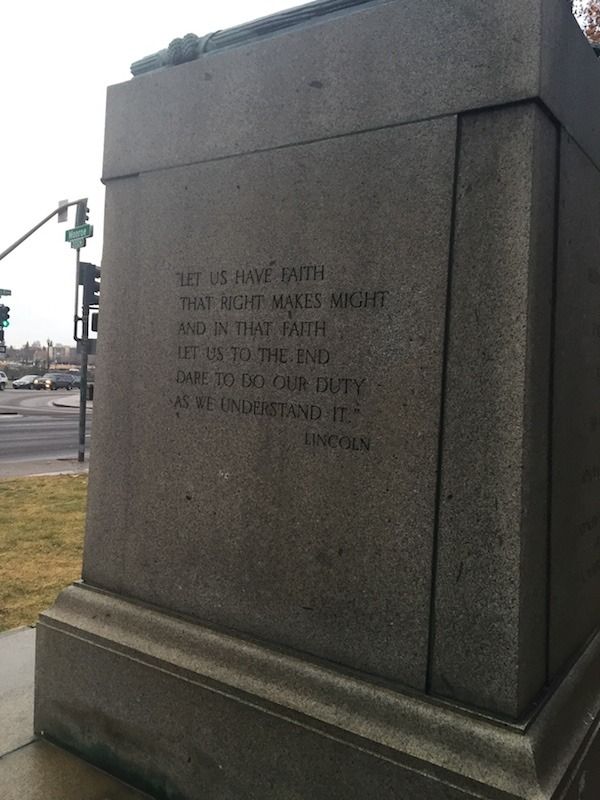 Quote on the Base of the Statue, Left Side